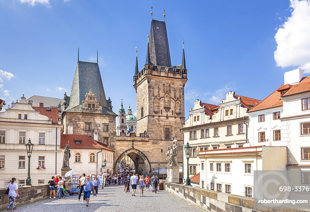 The Lesser Town Bridge Tower of Charles bridge with people visiting the Mala Strana district Prague Czech Republic Europe