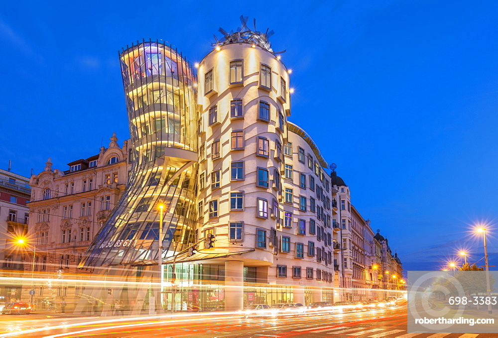 Dancing House or Ginger and Fred at night by Frank Gehry, busy traffic light trails, Prague, Bohemia, Czech Republic, EU, Europe