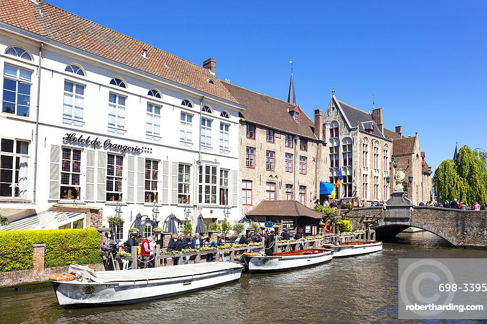 Boat tours on The Den Dijver Bruges canal in front of the Hotel De Orangerie in Bruges, Belgium, Europe