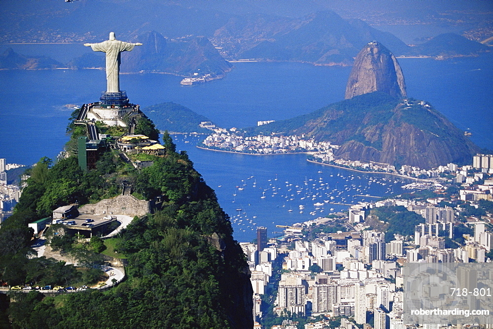 Statue of Christ the Redeemer overlooking city and Sugar Loaf mountain, Rio de Janeiro, Brazil, South America
