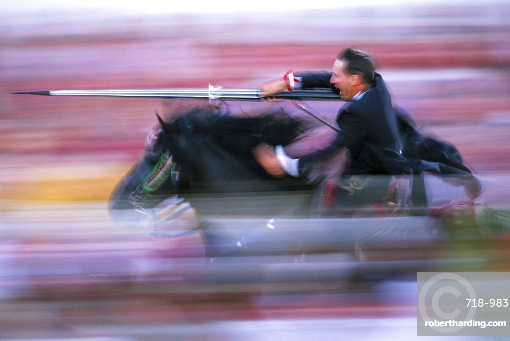 Rider speeding during the Medieval Games, festival celebrated on St. John's Day (Festa de Sant Joan), Ciutadella, Minorca (Menorca), Balearic Islands, Spain, Europe