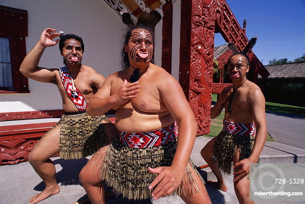 Portrait of three Maori men performing traditional dance, New Zealand, Pacific