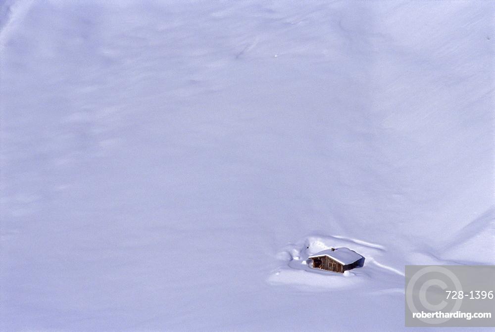 House in snow, St Anton, Austria