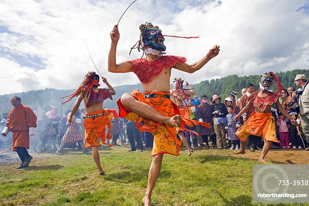 Dancers in costume at Thangbi Mani Tsechu (festival), Jakar, Bumthang, Chokor Valley, Bhutan, Asia