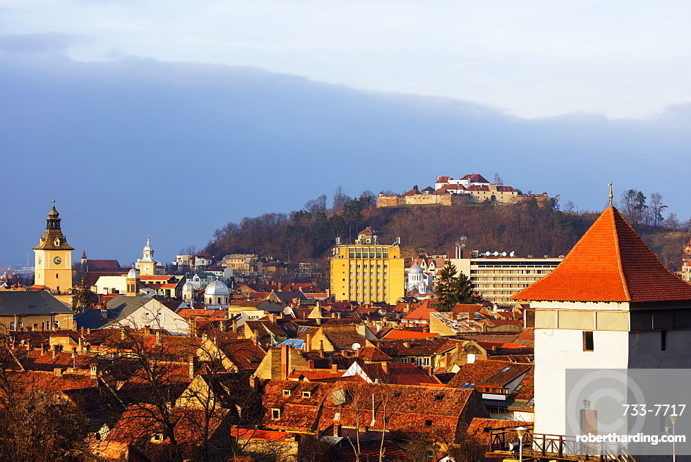 Church tower and old town houses below the citadel, Brasov, Romania, Europe