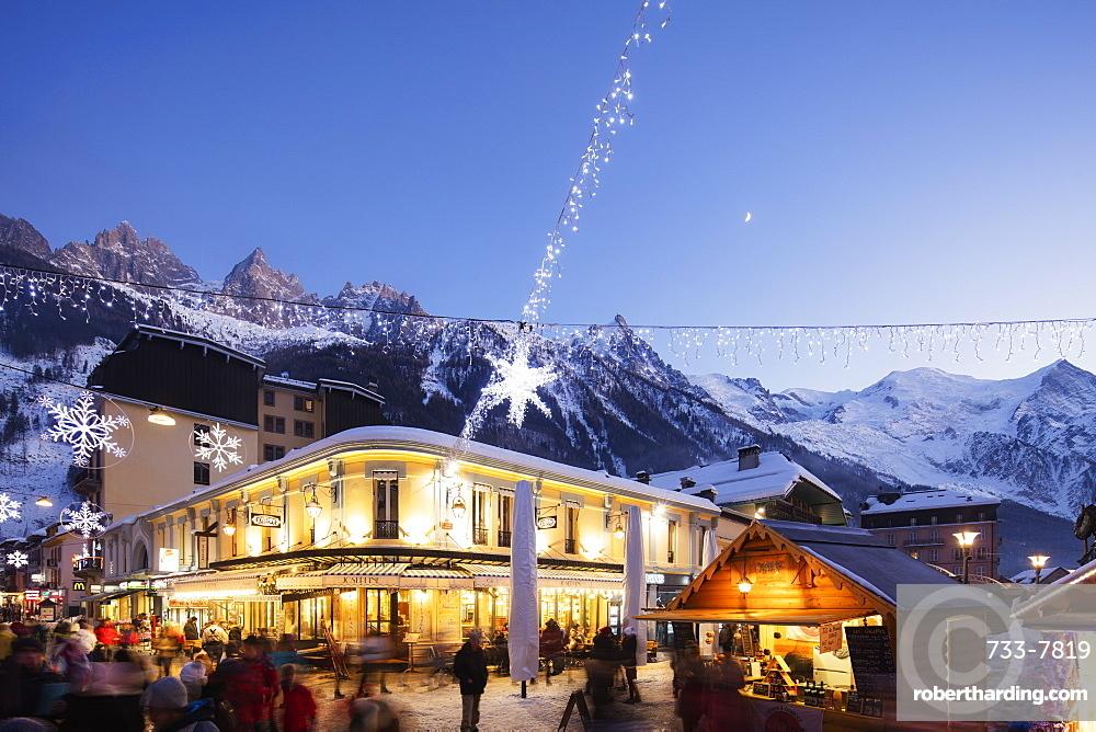 Christmas market decorations against backdrop of Mont Blanc mountain range, Chamonix, Haute Savoie, Rhone Alpes, France, Europe