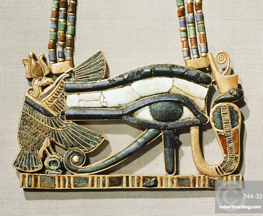 Pectoral of the sacred eye flanked by the serpent goddess of the North and the vulture goddess of the South, made from gold cloisonne with glass-paste, from the tomb of the pharaoh Tutankhamun, discovered in the Valley of the Kings, Thebes, Egypt, North Africa, Africa
