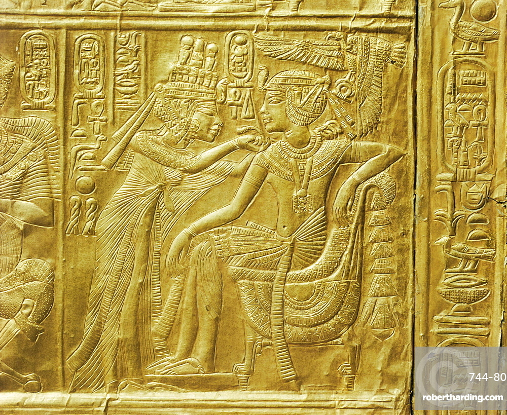 Detail of the exterior of the gilt shrine showing the queen fastening a necklace around the king's neck, from the tomb of the pharaoh Tutankhamun, discovered in the Valley of the Kings, Thebes, Egypt, North Africa, Africa