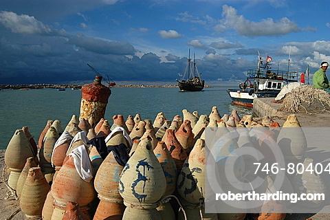 Fishing for octopus, Houmt Souk, Djerba, Tunisia, North Africa