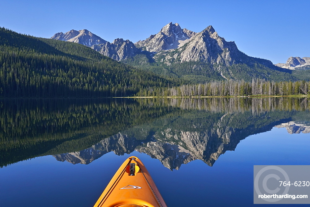 McGown Peak reflected in Stanley Lake while kayaking, Sawtooth National Recreation Area, Idaho, United States of America, North America