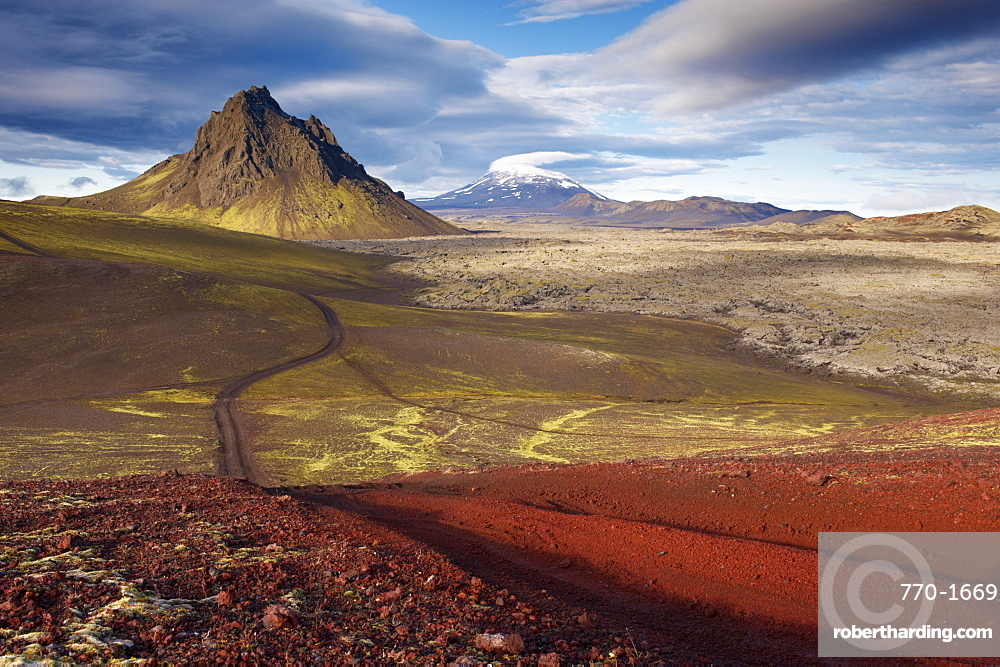 Mount Krakatindur, 858 m, standing solitary in the Nyjahraun lava field, east of Hekla volcano in the distance, Fjallabak route north (Nyrdri-Fjallaback) in the interior, Iceland, Polar Regions