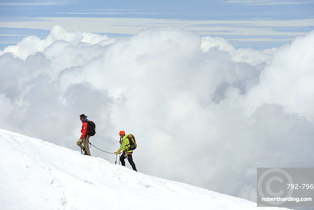 Mountaineers, climbers high up in the clouds, Aiguille du Midi, Mont Blanc Massif, Chamonix, Haute Savoie, French Alps, France, Europe
