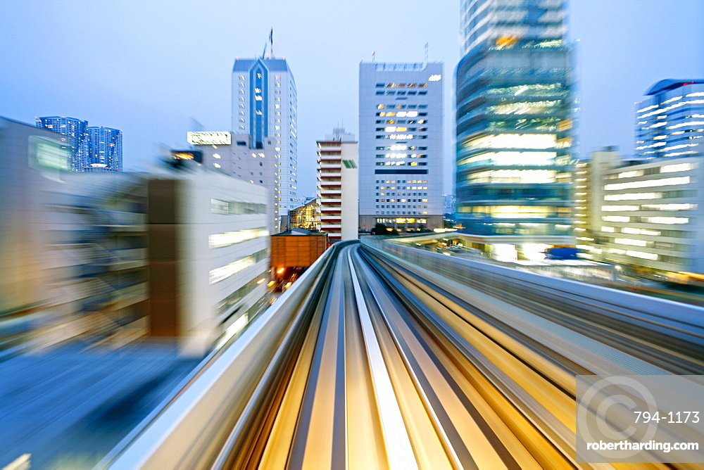 POV blurred motion of Tokyo buildings from a moving train, Tokyo, Honshu, Japan, Asia