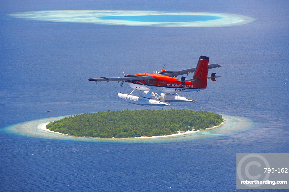Maldivian Air Taxi flying above island, Maldives, Indian Ocean, Asia
