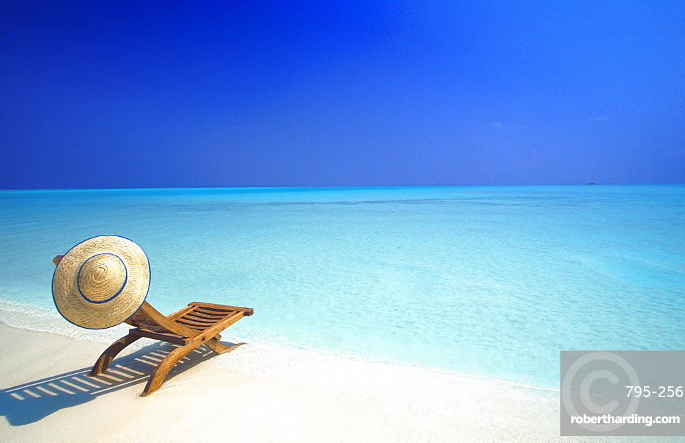 Wooden deckchair and hat on tropical beach, Maldives, Indian Ocean, Asia
