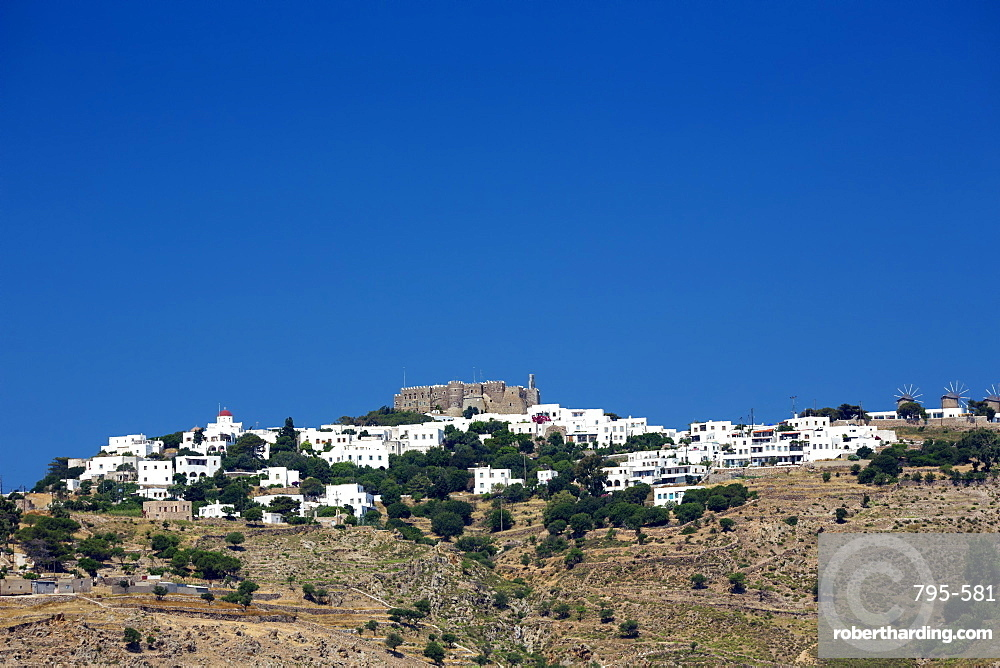 View of Chora town and Monastery of St. John the Evangelist, UNESCO World Heritage Site, Patmos Island, Greek Islands, Greece, Europe