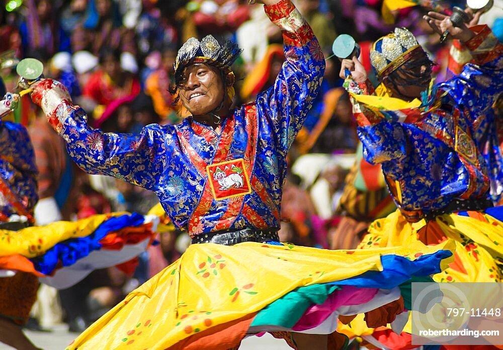 Bhutan, Thimpu Dzong, Dancers in the courtyard during festival.