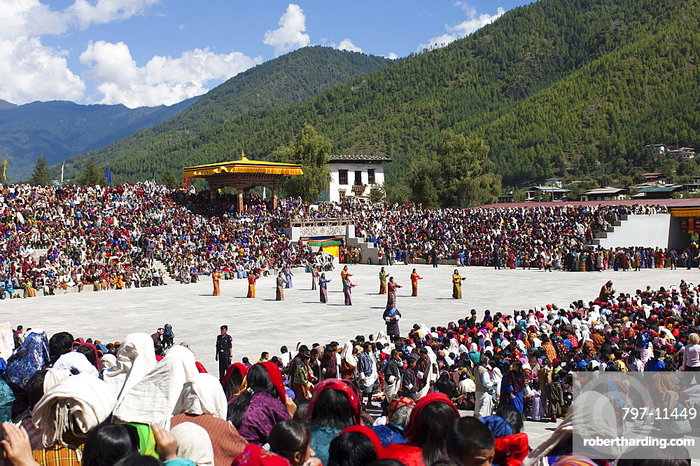 Bhutan, Thimpu Dzong, Dancers in the courtyard during festival.