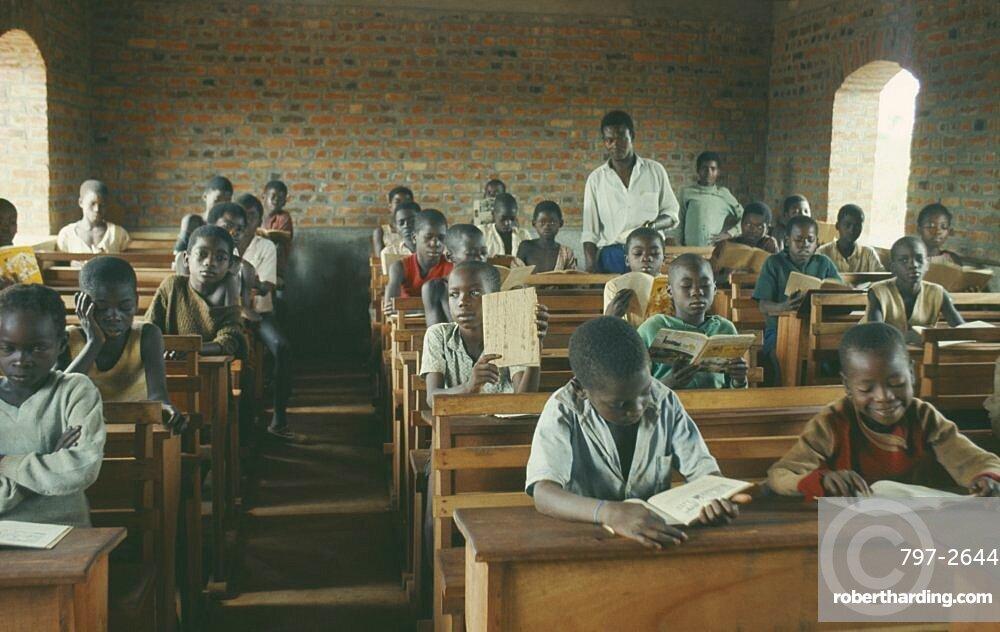 CONGO  Education Azande children sitting at wooden desks in school classroom. Zande Zaire