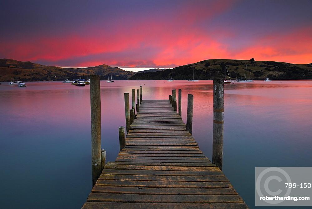Sunrise over Akaroa harbour, Banks Peninsula, South Island, New Zealand, Pacific