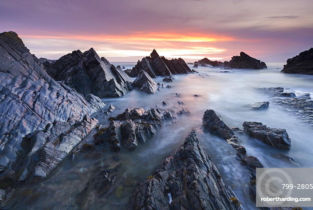 Rocky seascape at sunset, Hartland Quay, Devon, England, United Kingdom, Europe