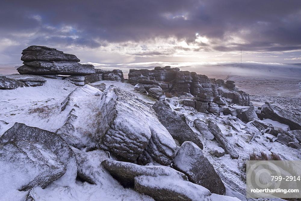 Snow covered granite rocks at Great Mis Tor in winter, Dartmoor National Park, Devon, England, United Kingdom, Europe