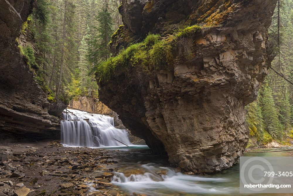Waterfall at the base of a deep gorge at Johnston Canyon, Banff National Park, UNESCO World Heritage Site, Canadian Rockies, Alberta, Canada, North America
