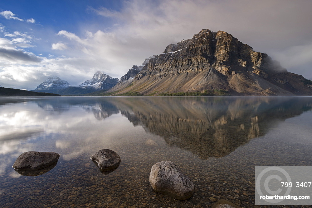 Crowfoot mountain reflection in the mirror still waters of Bow Lake, Banff National Park, UNESCO World Heritage Site, Alberta, Rocky Mountains, Canada, North America