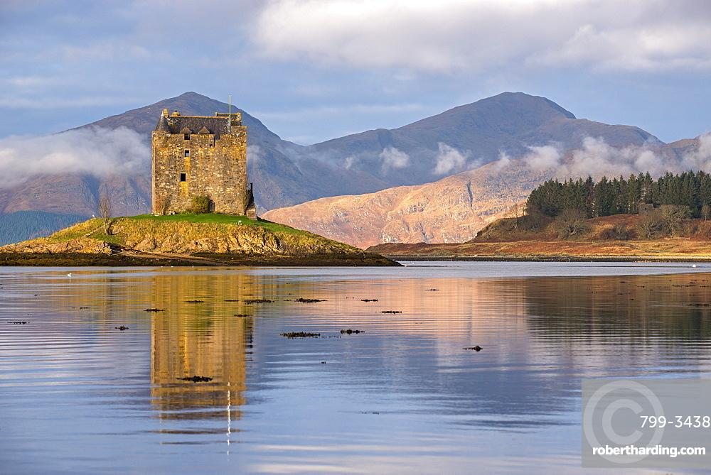 Castle Stalker reflected in Loch Linnhe in winter, Scottish Highlands, Scotland, United Kingdom, Europe