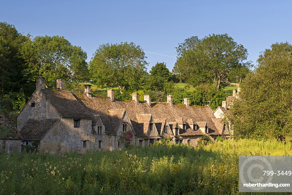 Arlington Row cottages in the Cotswold village of Bibury, Gloucestershire, England, United Kingdom, Europe