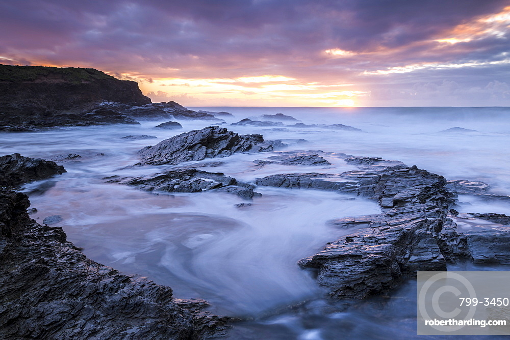 Sunset over the Atlantic from the rocky shores of Booby's Bay, Cornwall, England, United Kingdom, Europe