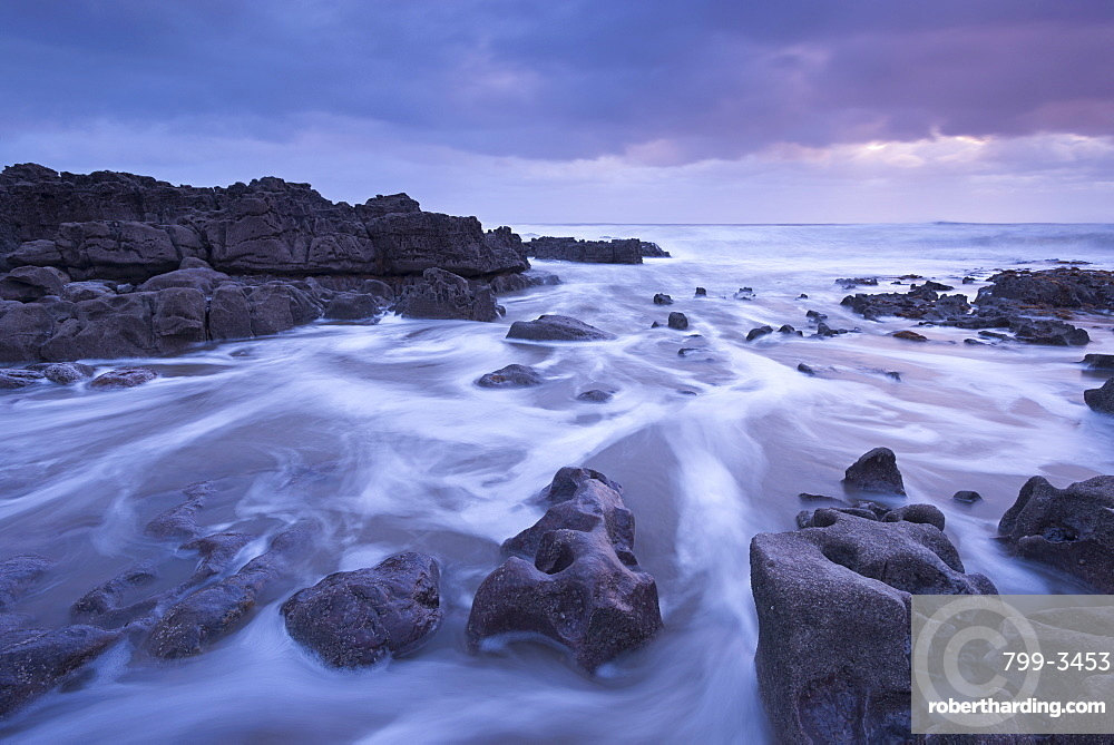 Sunset off the rugged coastline of Porthcawl on the Glamorgan coast, Wales, United Kingdom, Europe