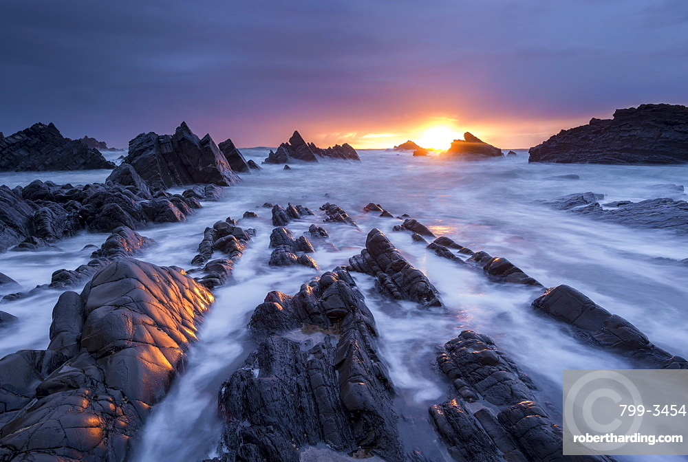 Dramatic sunset over the rocky ledges of Hartland Quay, Devon, England, United Kingdom, Europe