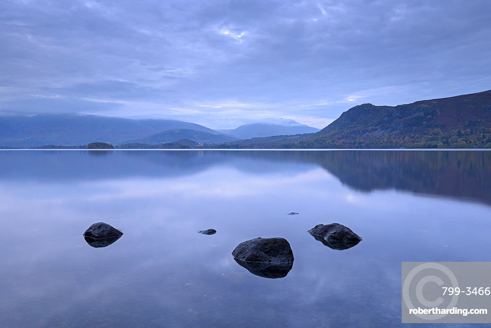 Reflections on a tranquil Derwent Water at dusk, Lake District National Park, Cumbria, England, United Kingdom, Europe