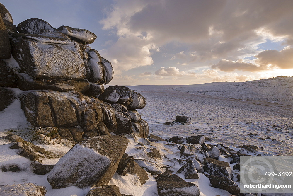 Snow covered granite tor and moorland, West Mill Tor, Dartmoor, Devon, England, United Kingdom, Europe