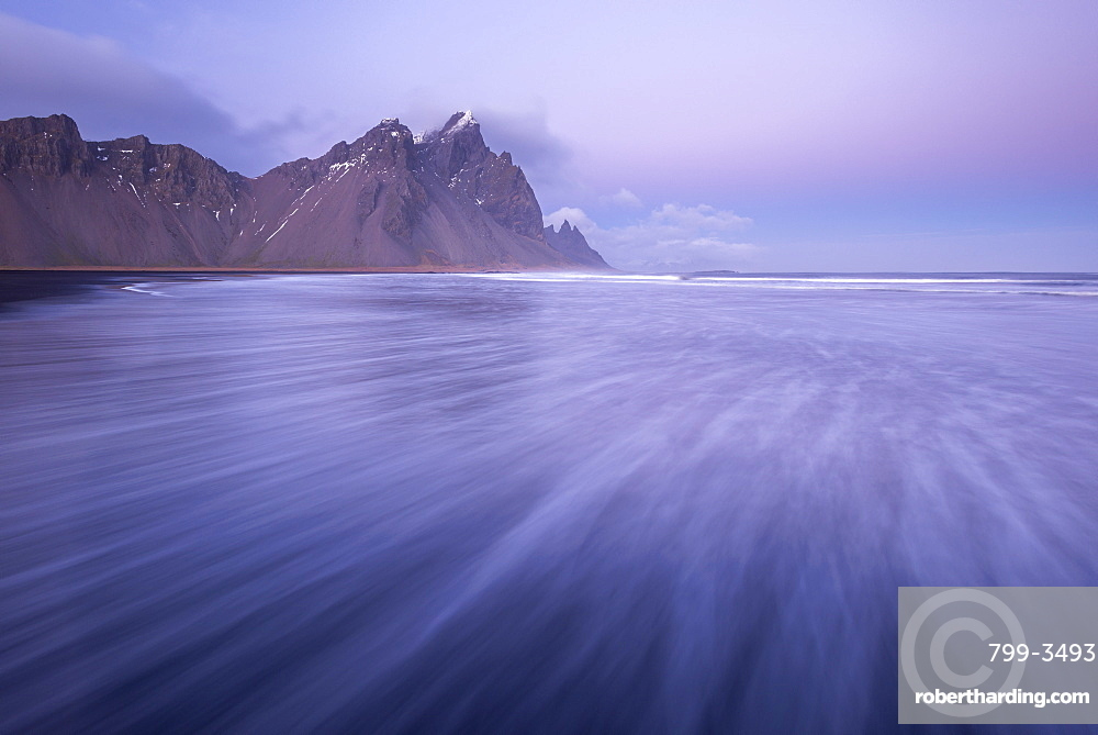 Pink pastel twilight on the shores of Vestrahorn in winter, Iceland, Polar Regions