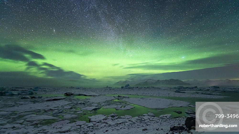 Aurora Borealis (Northern Lights) and Milky Way in the night sky above Jokulsarlon glacial lagoon, Iceland, Polar Regions