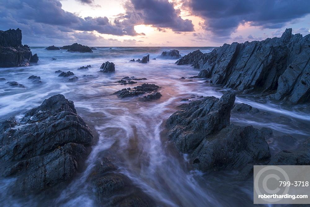 Sunset over the dramatic coastline of North Devon, England, United Kingdom, Europe