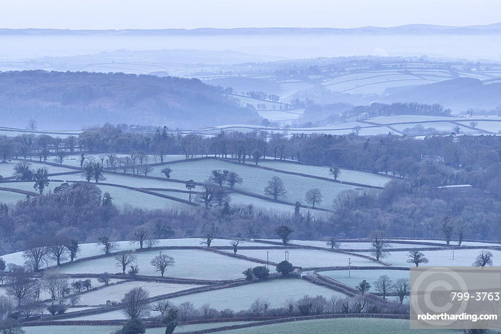 Frosty rolling countryside near Sourton, Devon, England. Winter (January) 2018.
