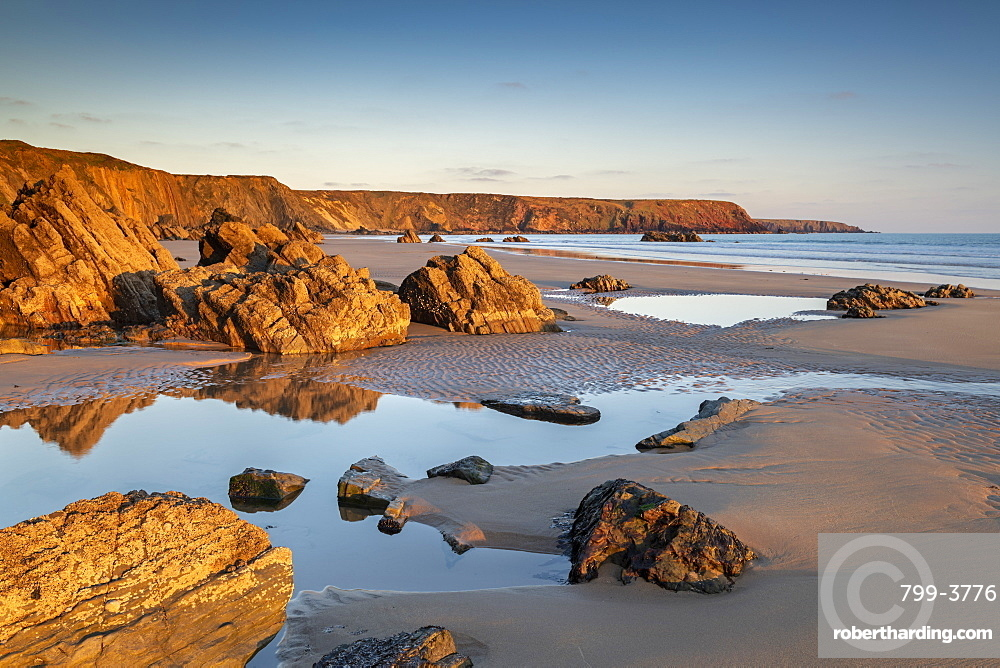 Late evening sunlight on a deserted Marloes Sands, Pembrokeshire, Wales. Spring (March) 2019.