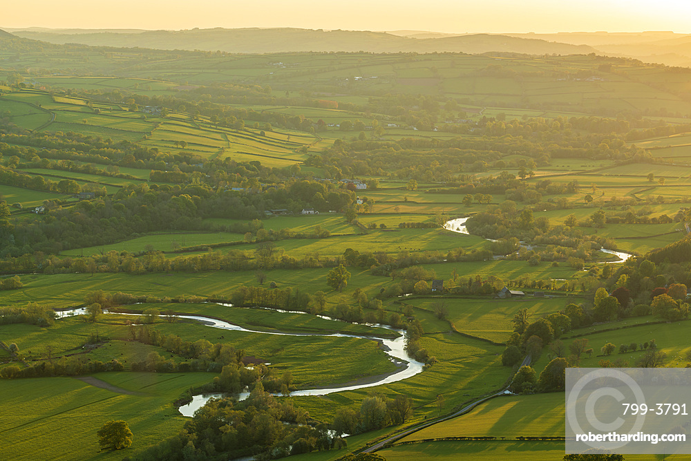 The River Usk meandering through rolling countryside, Brecon Beacons, Powys, Wales, UK. Spring (May) 2019.