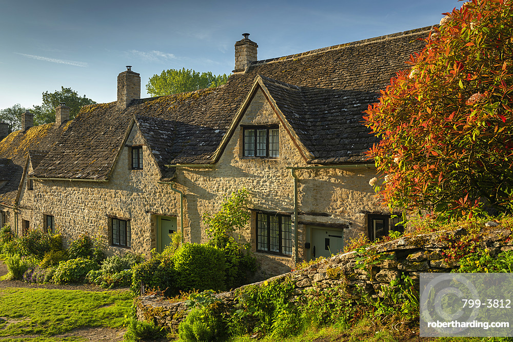 Idyllic cottages in Arlington Row in the pretty Cotswolds village of Bibury, Gloucestershire, England. Spring (May) 2019.