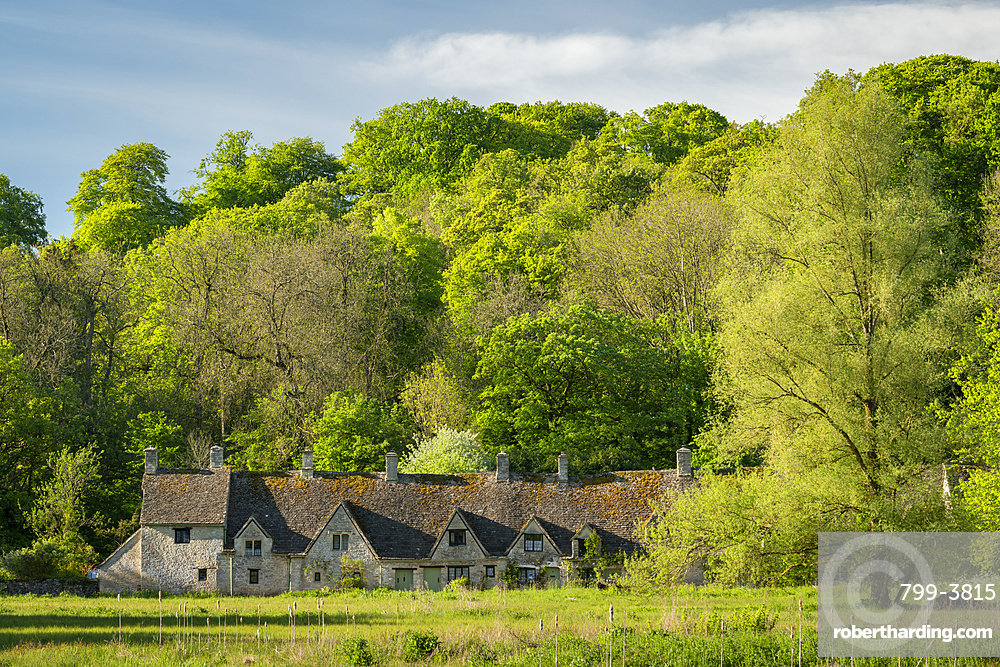 Arlington Row cottages in the pretty Cotswolds village of Bibury, Gloucestershire, England. Spring (May) 2019.