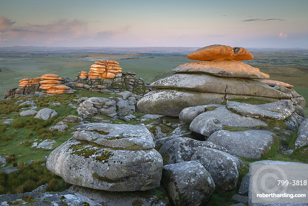 First light on Roughtor at sunrise, Bodmin Moor, Cornwall, England. Spring (June) 2019.