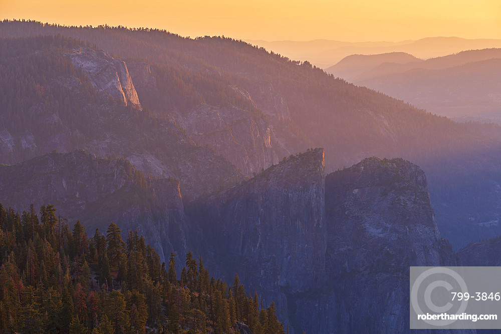 Sunset over Cathedral Peaks and Yosemite Valley, from Sentinel Dome, Yosemite, California, USA. Spring (June) 2016.