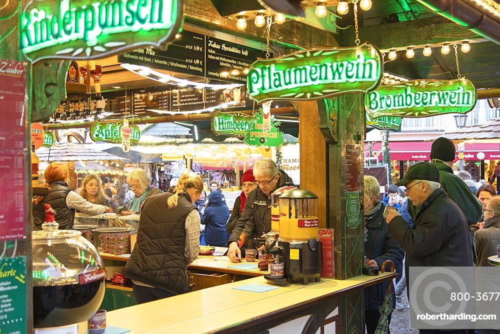 People at German mulled wine stall at Frankfurt Christmas Market, Frankfurt am Main, Hesse, Germany