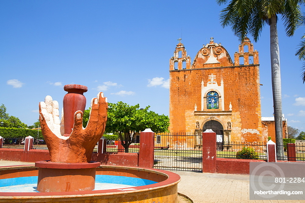 Hands Fountain in foreground, Church of San Antonio de Padua in background, Ticul, Yucatan, Mexico, North America
