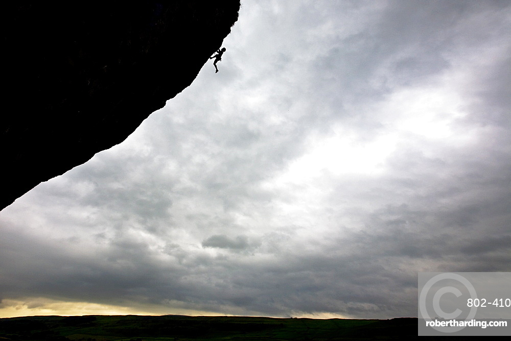 Rock climber in action, Kilnsey Crag, North Yorkshire, Yorkshire, England, United Kingdom, Europe