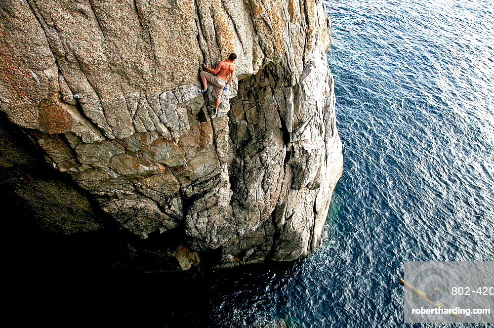 Rock climber in action, Lundy Island, North Devon, England, United Kingdom, Europe
