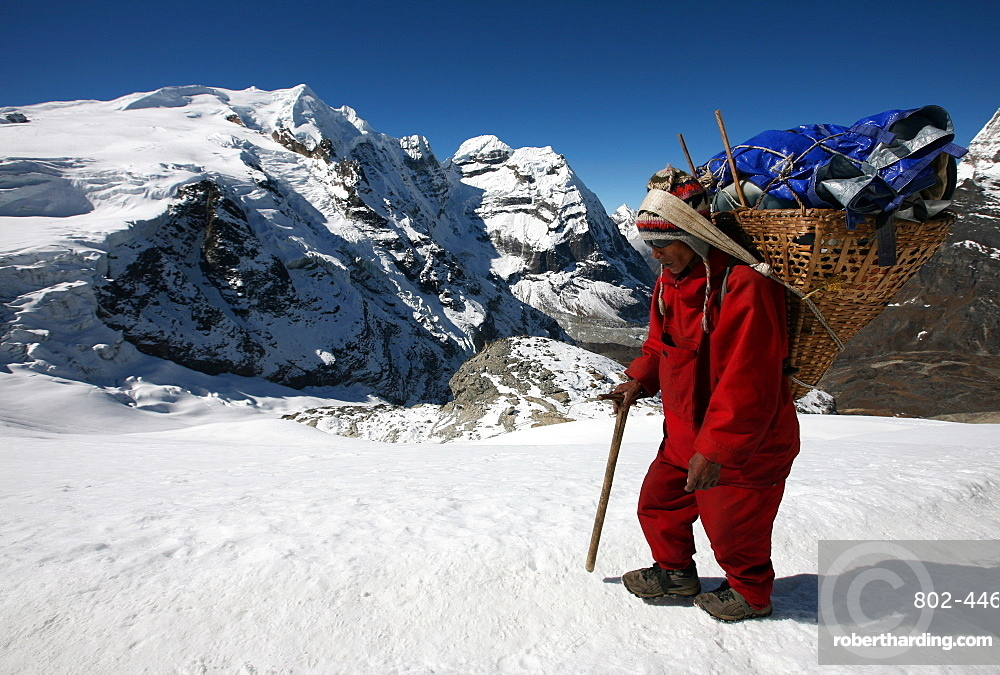 Porter carrying a load on Mera Peak, Solukhumbu, Nepal, Asia